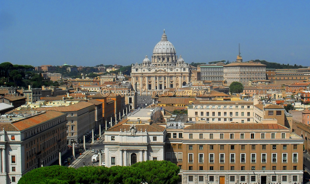 Distant shot of Saint Peter's Square or the Piazza San Pietro, a large plaza which stands in front of St. Peter's Basilica in the Vatican City, Italy. Placed in the centre is a 4,000 year-old Egyptian obelisk, which was places there in 1568. The actual square was designed by Gian Lorenzo Bernini almost 100 years later. The square also has 2 matching granite fountains, constructed by Carlo Maderno around 1613 and Bernini in 1675.