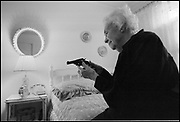 Ann Vollmer, 102, keeps a loaded pistol by her bed in Washington IN. for protection. She has had to use weapons in the past to ward off poachers on her land.