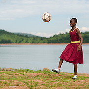 Patience (13), pictured on the shores of Lake Volta in Ghana on 16 May 2014, is a student and keen soccer player.  She says her favourite subject is ICT, but her school has no computers, so her class relies entirely on textbooks.