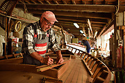 San Pietro island,  Carloforte. Tonino Sanna, one of the last two shipwright of the island. Carloforte boasts a long-standing tradition of wooden boatbuilding. In the 18th century the then-uninhabited San Pietro was colonized by people of Ligurian language and ethnicity, coming from the Republic of Genoa's colony at Tabarka after it had been taken over by the Bey of Tunisia. Today most of the population has retained a variant of Genoese dialect, called Tabarchino,