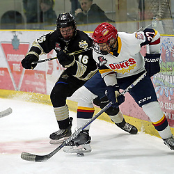 WELLINGTON, ON - JANUARY 18: Brad Lindsay #16 of the Trenton Golden Hawks battle for the puck with Elijah Gonsalves #27 of the Wellington Dukes on January 18, 2019 at Wellington and District Community Centre in Wellington, Ontario, Canada.<br /> (Photo by Ed McPherson / OJHL Images)
