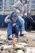 Girl Scouts build a fire so they can roast marshmallows and make s'mores during Program Aide (PA) training at the Girl Scouts urban campus in Dayton, Saturday, March 3, 2012.
