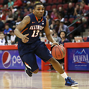 Tracy Abrams #13 of the Illinois Fighting Illini drives with the ball during the NIT First Round game at Agganis Arena on March 19, 2014 in Boston, Massachusetts . (Photo by Elan Kawesch)