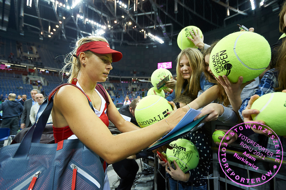 Maria Sharapova from Russia signs her autographs during First Day of the Fed Cup / World Group 1st round tennis match between Poland and Russia at Tauron Krakow Arena on February 7, 2015 in Cracow, Poland.<br /> <br /> Poland, Cracow, February 7, 2015<br /> <br /> Picture also available in RAW (NEF) or TIFF format on special request.<br /> <br /> For editorial use only. Any commercial or promotional use requires permission.<br /> <br /> Adam Nurkiewicz declares that he has no rights to the image of people at the photographs of his authorship.<br /> <br /> Mandatory credit:<br /> Photo by &copy; Adam Nurkiewicz / Mediasport