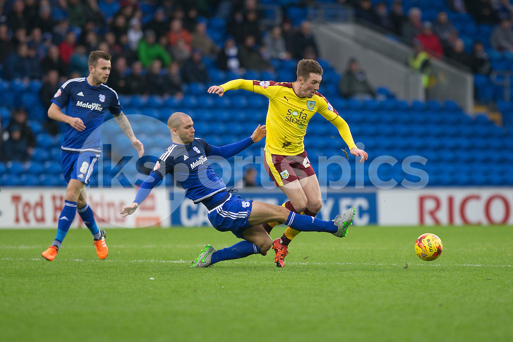 Matthew Connolly of Cardiff City challenges Chris Long of Burnley during the Sky Bet Championship match between Cardiff City and Burnley at the Cardiff City Stadium, Cardiff, Wales on 28 November 2015. Photo by Mark Hawkins.