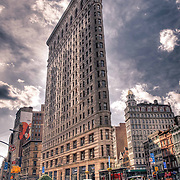 The Flatiron Building is one of the most famous historic landmarks in New York. The iconic twenty-one story building, best known for its triangular shape, was one of the early spectacular high-rises that have come to define Manhattan.