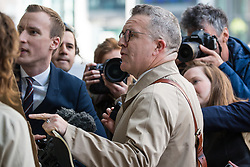 London, UK. 30th April 2019. Tom Watson, Deputy Leader of the Labour Party, debates with an activist from Movement for Justice calling for freedom of movement to be maintained as he arrives for a Labour Party NEC meeting to confirm plans for Labour's EU election manifesto, including its stance with regard to a second referendum.