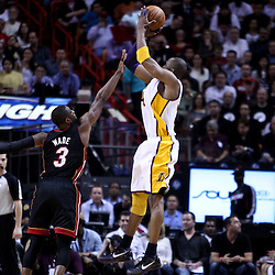 March 10, 2011; Miami, FL, USA; Los Angeles Lakers shooting guard Kobe Bryant (24) is guarded by Miami Heat shooting guard Dwyane Wade (3) during the third quarter at the American Airlines Arena. The Heat defeated the Lakers 94-88.   Mandatory Credit: Derick E. Hingle