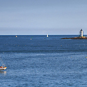 Sail boat, Portsmouth Harbor Ligth and old Fort Constiution at entrance to Portsmouth Harbor, viewed from Fort McClaryin Kittery Point, ME