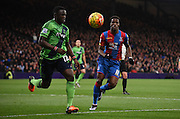 Wilfred Zaha closes down Victor Wanyama during the Barclays Premier League match between Crystal Palace and Southampton at Selhurst Park, London, England on 12 December 2015. Photo by Michael Hulf.