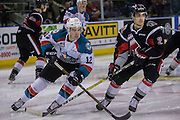 KELOWNA, CANADA - JANUARY 18:  Erik Gardiner #12 of the Kelowna Rockets, Josh Brook #2 of the Moose Jaw Warriors at the Kelowna Rockets game on January 18, 2017 at Prospera Place in Kelowna, British Columbia, Canada.  (Photo By Cindy Rogers/Nyasa Photography,  *** Local Caption ***