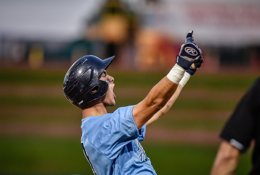 rer051317f/sports/May 13, 2017/Albuquerque Journal<br /> La Cueva's Isaac Standridge (Cq) celebrates after safely reaching third base Saturday evening  at Isotopes Park.  La Cueva defeated Cleveland and captured the 6A title. <br /> Roberto E. Rosales/Albuquerque Journal Photo by Roberto E. Rosales