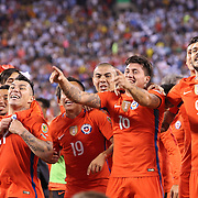EAST RUTHERFORD, NEW JERSEY - JUNE 26: Gary Medel #17 of Chile, Nicolas Castillo #16 of Chile and Mauricio Pinilla #9 of Chile and other team members celebrate victory after their penalty shoot out win during the Argentina Vs Chile Final match of the Copa America Centenario USA 2016 Tournament at MetLife Stadium on June 26, 2016 in East Rutherford, New Jersey. (Photo by Tim Clayton/Corbis via Getty Images)
