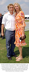 Model JODIE KIDD and MR TARQUIN SOUTHWELL, at a polo match in Berkshire on 28th July 2002.PCL 309