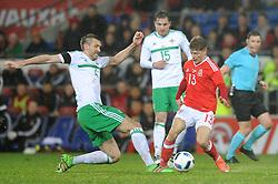Gareth McAuley of Northern Ireland Lloyd Isgrove of Wales - Mandatory by-line: Dougie Allward/JMP - Mobile: 07966 386802 - 24/03/2016 - FOOTBALL - Cardiff City Stadium - Cardiff, Wales - Wales v Northern Ireland - Vauxhall International Friendly