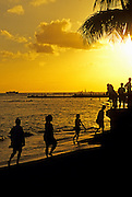 Image of a sunset on Waikiki Beach, Honolulu, Oahu, Hawaii, America West.