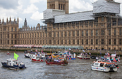 © Licensed to London News Pictures. 15/06/2016. London, UK. A flotilla of fishing trawlers, led by UKIP leader Nigel Farage, arrive outside Westminster to coincide with David Cameron's appearance at Prime Ministers Questions. The flotilla is organised by the 'Fishing for Leave' campaign, founded by Scottish fisherman, which argues that the UK's fishing industry would be better off outside the EU, but with the same status as Iceland or Norway when fishing quotas are negotiated. Photo credit: Rob Pinney/LNP