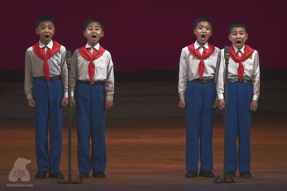 Boys wearing the typical scarves associated with the communist 'Pionner' movement perform on stage, at the Mangyongdae Children's Palace, in Pyongyang. This is a public facility where children are engaged in extra-curricular activities, such as learning music, foreign languages, computing programming and sports. During my first visit to Pyongyang, I was invited to a dance, music, gymnastics and singing extravaganza involving a large number of incredibly gifted young people extolling the virtues of socialism and praising the wise guidance of North Korea's leaders.