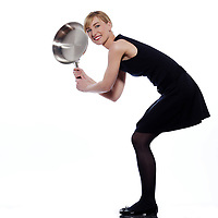 beautiful woman on studio white background holding a frying pan