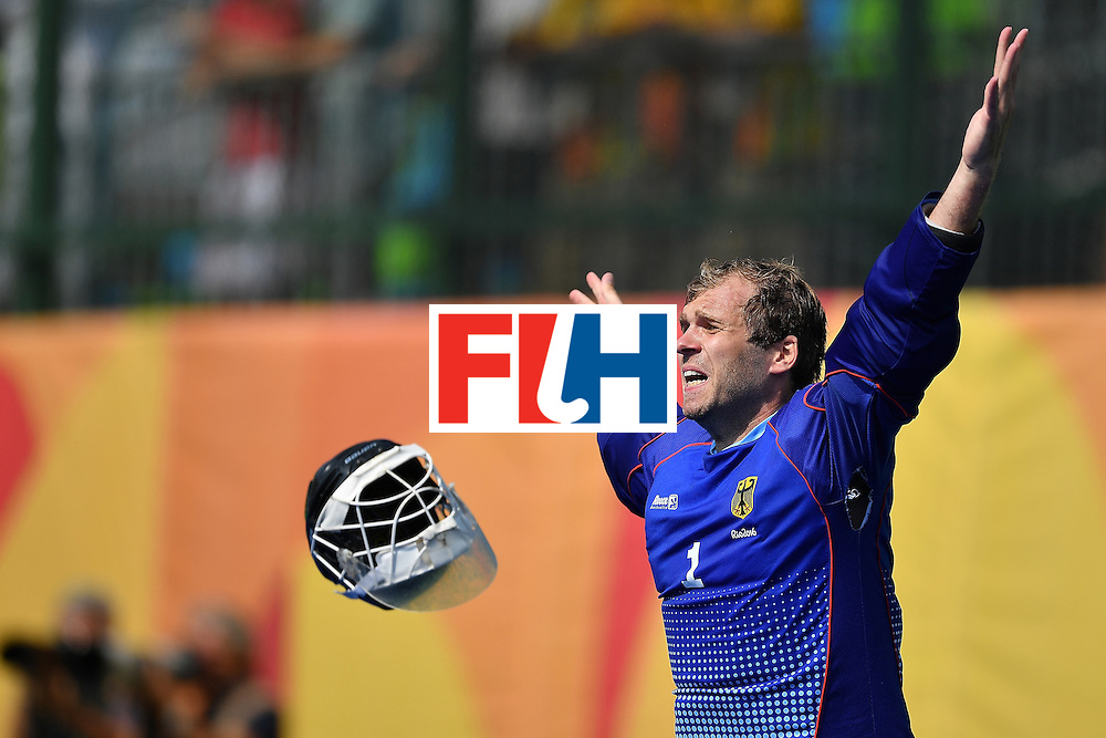 RIO DE JANEIRO, BRAZIL - AUGUST 18:  Goalkeeper of Germany Nicolas Jacobi celebrates after saving the shot from Sander De Winj to win the penalty shoot out and Bronze medal during the Mens's Bronze medal match between the Netherlands and Germany on Day 13 of the Rio 2016 Olympic games at Olympic Hockey Center on August 18, 2016 in Rio de Janeiro, Brazil.  (Photo by Pascal Le Segretain/Getty Images)