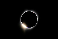 A diamond ring is seen just before totality during the solar eclipse in Dallas Ore., on August 21, 2017. (Photo by Alex Milan Tracy)