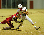 Brandon Frizell drags down Chisholm's Colton Johnson. - Nicholas Rutledge / For The Transcript