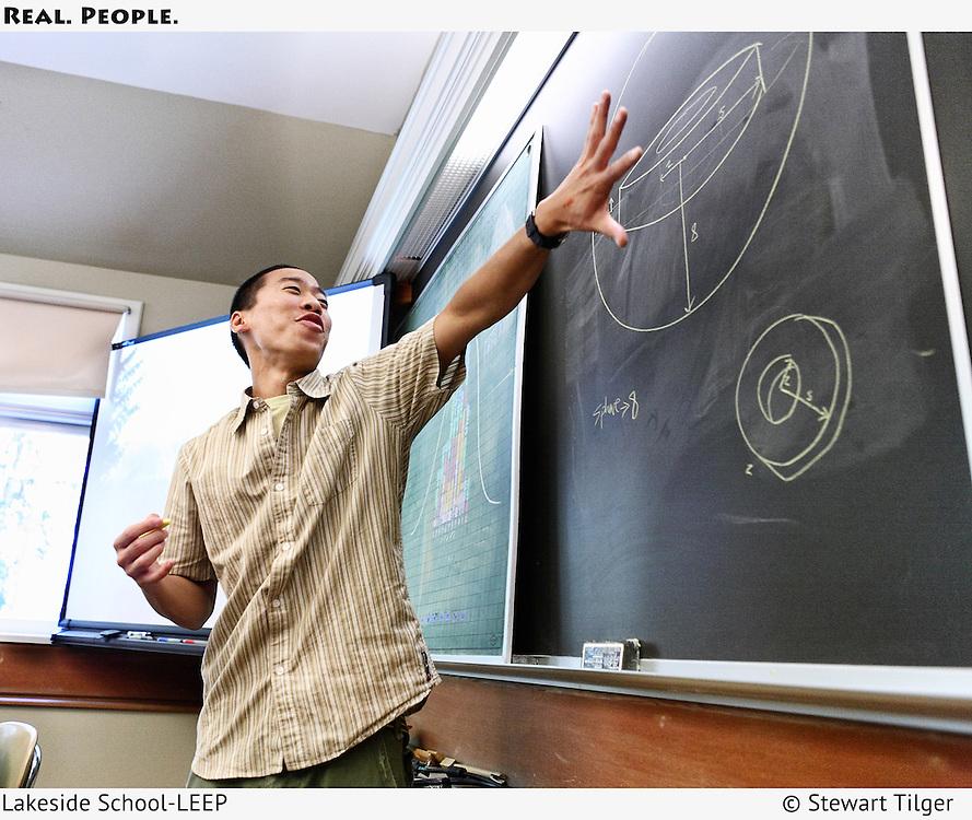 A Lakeside Educational Enrichment Program (LEEP) teacher at the blackboard teaching math.