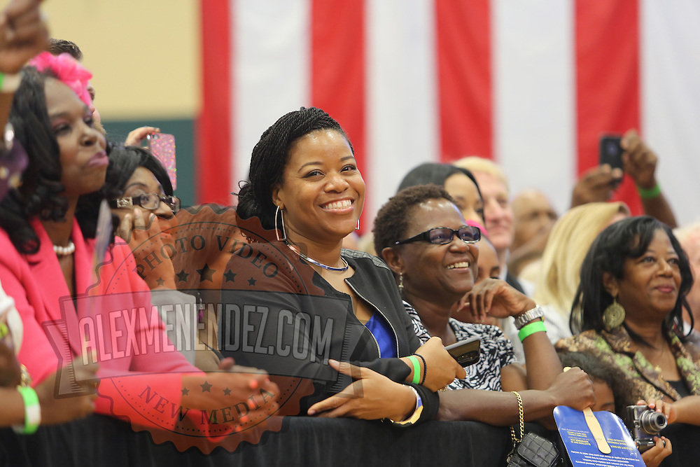 "Supporters smile prior to the ""Commit to Vote"" rally for Democrat Charlie Crist who is running for Governor of the state of Florida. The campaign called on the event to "" energize voters and lay out the stakes for Floridians in the critical election on November 4th."" at the Barnett Park Gymnasium in Orlando, Florida on Friday, Nov. 17, 2014. (AP Photo/Alex Menendez)"