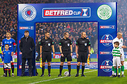 Match Referee William Collum alongside Asst Referee David Roome & Asst Referee Alan Mulvanny await the teams  ahead of the Betfred Scottish League Cup Final match between Rangers and Celtic at Hampden Park, Glasgow, United Kingdom on 8 December 2019.