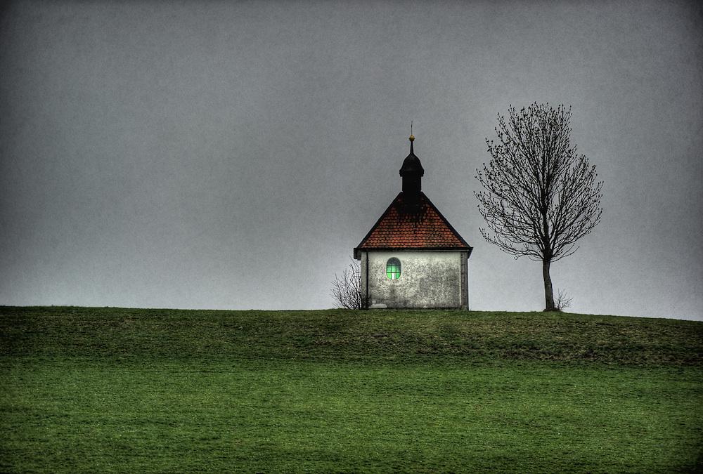 Small chapel and tree