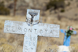 weathered cross in a cemetery in New Mexico