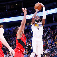 09 April 2018: Denver Nuggets forward Will Barton (5) takes a jump shot over Portland Trail Blazers guard CJ McCollum (3) during the Denver Nuggets 88-82 victory over the Portland Trail Blazers, at the Pepsi Center, Denver, Colorado, USA.