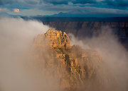 Vishnu Temple emrges from the clouds. Viewed from Cape Royal on the North Rim of Grand Canyon National Park in Arizona.