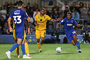 AFC Wimbledon defender Nesta Guinness-Walker (18) battles for possession with Milton Keynes Dons attacker Jordan Bowery (9) during the EFL Cup match between AFC Wimbledon and Milton Keynes Dons at the Cherry Red Records Stadium, Kingston, England on 13 August 2019.