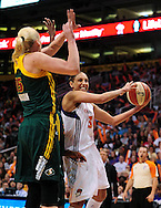 Sep 17 2011; Phoenix, AZ, USA; Phoenix Mercury guard Diana Taurasi (3) drives the ball against Seattle Storm forward Lauren Jackson (15) during the first half at the US Airways Center.  The Mercury defeated the Storm 92 - 83. Mandatory Credit: Jennifer Stewart-US PRESSWIRE.