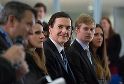 Image ©Licensed to i-Images Picture Agency. 06/06/2014. London, United Kingdom. George Osborne listens to the journalist questions while Christine Lagarde answers questions about global economy and UK economy recovery at HM Treasury. Picture by Daniel Leal-Olivas / i-Images