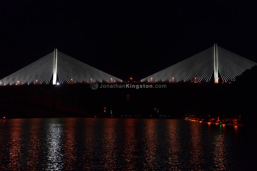 Night view of Panama's Centennial Bridge (Puente Centenario) from the Panama Canal, Panama.