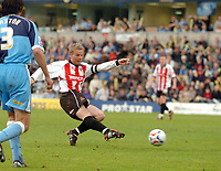 Photo: Leigh Quinnell.<br /> Wycombe Wanderers v Cheltenham Town. Coca Cola League 2, Play off Semi Final. 13/05/2006. Cheltenhams captain John Finnigan fires in a goal.