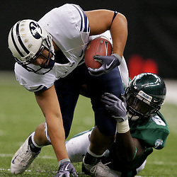 Sep 12, 2009; New Orleans, LA, USA;  BYU Cougars running back Harvey Unga (45) is tackled by Tulane Green Wave linebacker Travis Burks (6) during the first half at the Louisiana Superdome.  BYU defeated Tulane 54-3. Mandatory Credit: Derick E. Hingle-US PRESSWIRE