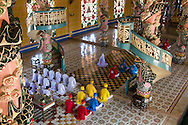 Worshipers line up during a ceremony in Cao Dai Temple, Tay Ninh, Vietnam, Southeast Asia