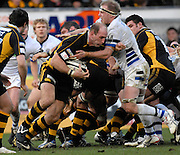 Wycombe, GREAT BRITAIN,  Lawrence DALLAGLIO, tackled by James SCAYSBROOK as he breaks from the scrum with the ball during the Guinness Premiership game London Wasps v Bath Rugby, at Adams Park, Bucks  29/12/2007 [Mandatory Credit Peter Spurrier/Intersport Images]