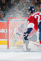 KELOWNA, CANADA - MARCH 27: Eric Comrie #1 of Tri-City Americans gets caught in a snow spray against the Kelowna Rockets on March 27, 2015 at Prospera Place in Kelowna, British Columbia, Canada.  (Photo by Marissa Baecker/Shoot the Breeze)  *** Local Caption *** Eric Comrie;