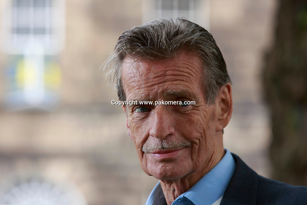 William McIlvanney photographed in Charlotte Square Gardens during Edinburgh International Book Festival 2014.