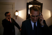 Cavaco Silva and his Press Assistant speaking on the mobile phones at the same time.