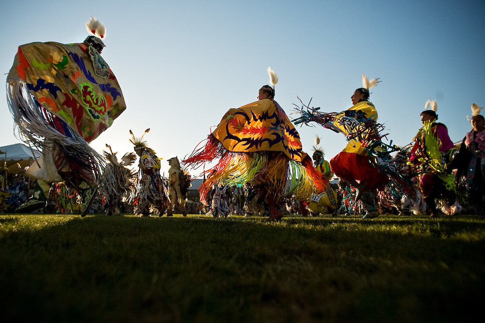 JEROME A. POLLOS/Press..Female dancers circle the men during the grand entrance of the Julyamsh Powwow in Post Falls.