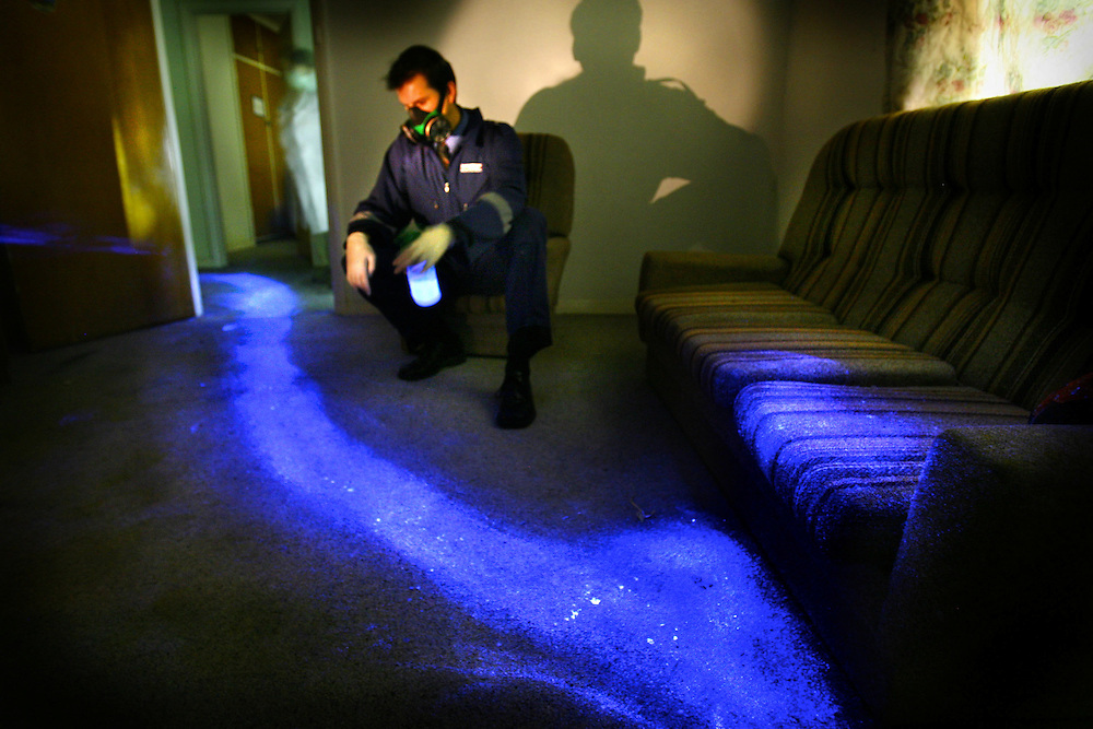 Steven Fowler of police forensics shows how Luminol Blood Detection Reagent Spray shows up bloody drag marks which may be undetectable in daylight. This image of a scene which might be of a location where a person was murdered and dragged away was actually created using pig's blood  Pic By Craig Sillitoe melbourne photographers, commercial photographers, industrial photographers, corporate photographer, architectural photographers, This photograph can be used for non commercial uses with attribution. Credit: Craig Sillitoe Photography / http://www.csillitoe.com<br />