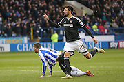 Brentford defender Yoann Barbet brings down Sheffield Wednesday forward Gary Hooper and gets the red card and sent off during the Sky Bet Championship match between Sheffield Wednesday and Brentford at Hillsborough, Sheffield, England on 13 February 2016. Photo by Simon Davies.