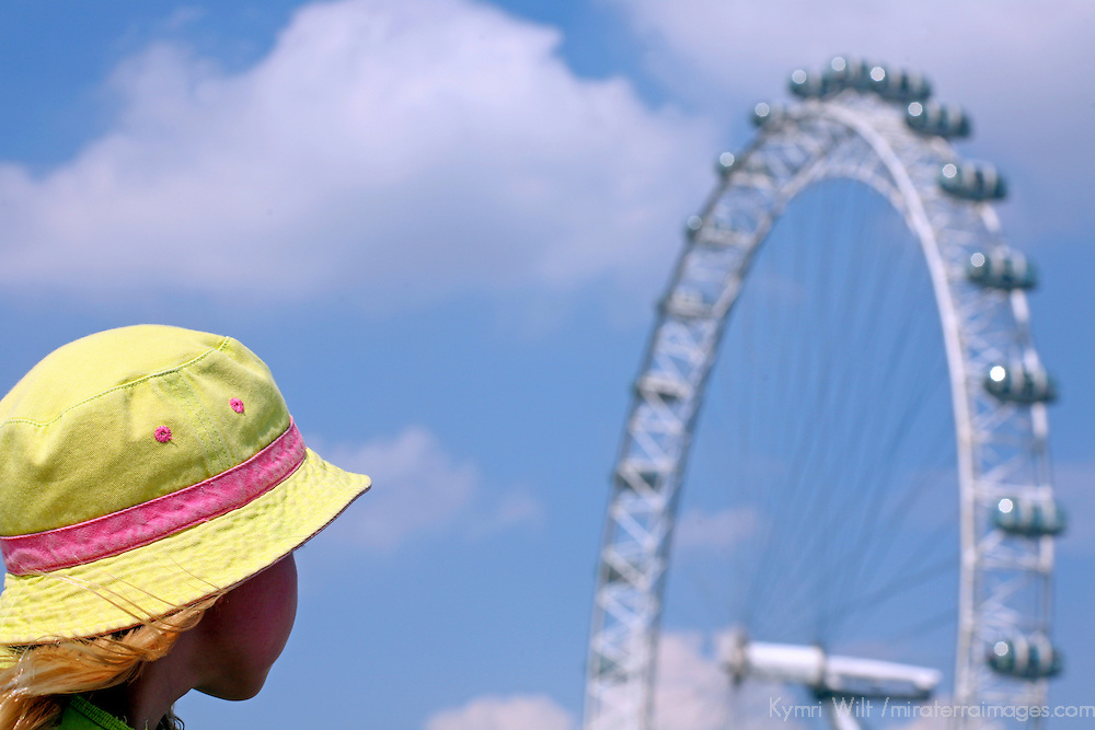 Europe, United Kingdom, England, London. Young girl views the London Eye Ferris Wheel on a summer's day.