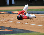 Mississippi's Zach Miller (1) reacts to being hit by a pitch vs. St. John'svs. St. John's during an NCAA Regional game at Davenport Field in Charlottesville, Va. on Sunday, June 6, 2010.