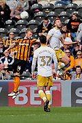 Hull City defender Max Clark (24) and Sheffield Wednesday forward Jordan Rhodes (7) battles for possession whilst Sheffield Wednesday midfielder Joey Pelupessy (32) looks on during the EFL Sky Bet Championship match between Hull City and Sheffield Wednesday at the KCOM Stadium, Kingston upon Hull, England on 14 April 2018. Picture by Mick Atkins.
